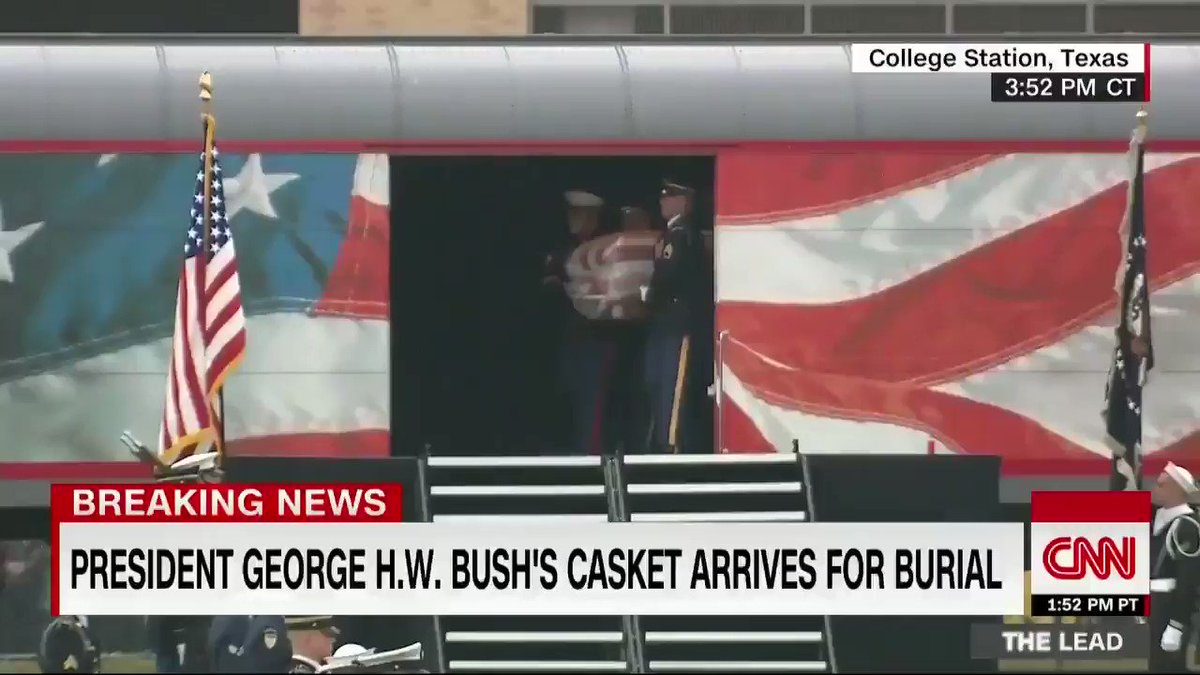 """Former President George H.W. Bush's casket is carried off his funeral train, with a special locomotive dubbed """"Bush 4141,"""" after arriving at Texas A&M University in College Station, Texas. https://cnn.it/2UlSd0R"""