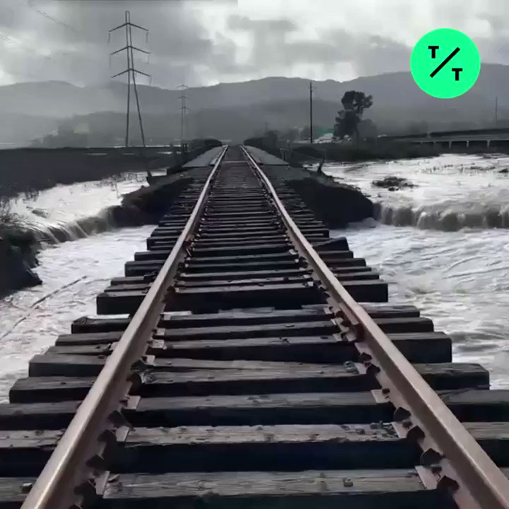 A California storm has broken a levee and damaged railroad tracks