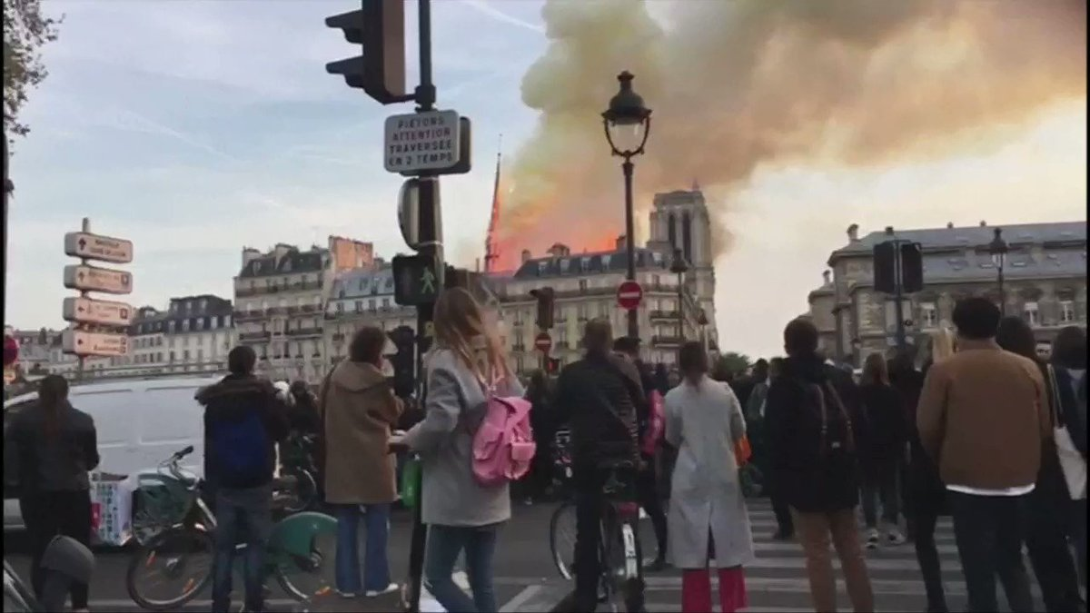 The spire collapses at Paris' Notre-Dame Cathedral as the centuries-old landmark is engulfed in flames https://reut.rs/2KGXqzz