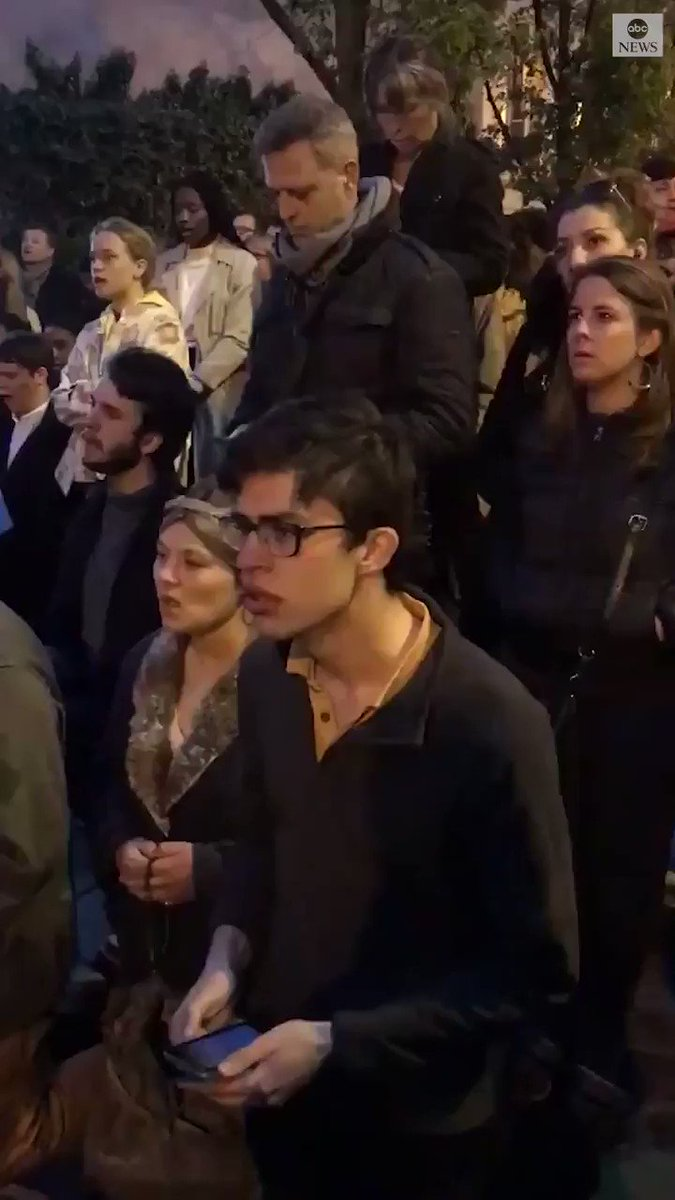 Mourning crowd sings Ave Maria outside Notre Dame cathedral amid devastating fire. abcn.ws/2KDfgDy