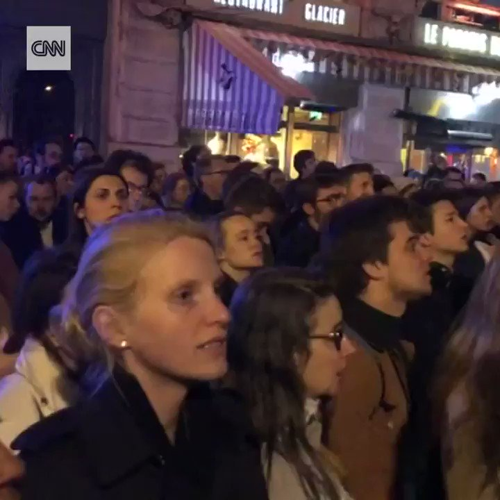 Crowds gathered to sing hymns outside the Notre Dame cathedral on Monday evening after the Parisian landmark was engulfed in flames https://cnn.it/2UK4AYE