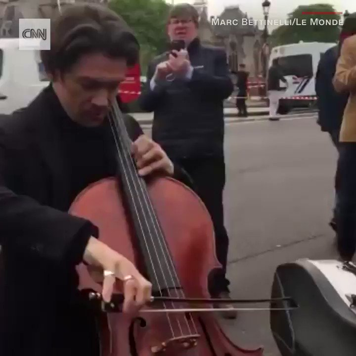 A day after Paris watched a piece of its history burn, French cellist Gautier Capuçon performed in front of the Notre Dame cathedral to send a message of hope https://cnn.it/2XkHODr
