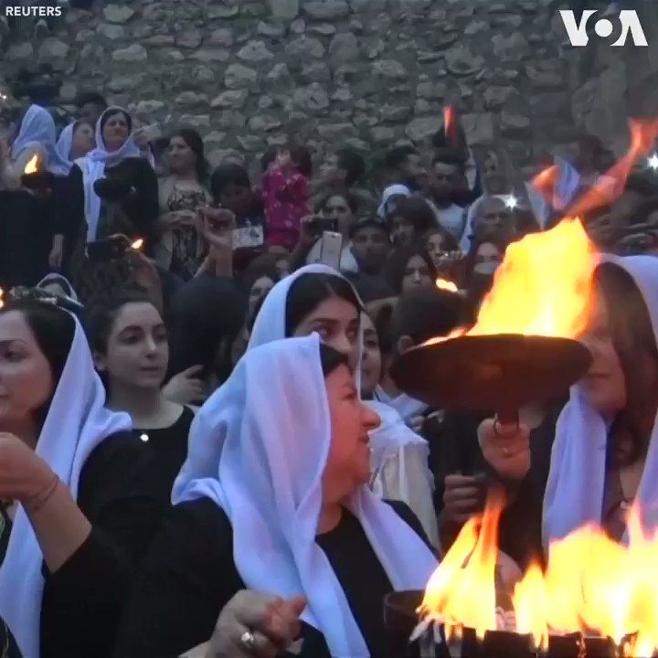 Hundreds of Yazidis gather at the holy temple of Lalish in the city of Dohuk, Iraq to celebrate the Yazidi New Year, Tuesday, April 16. The celebrations come two years after Islamic State militants were driven out. Men and women hold candles and torches around the holy temple.