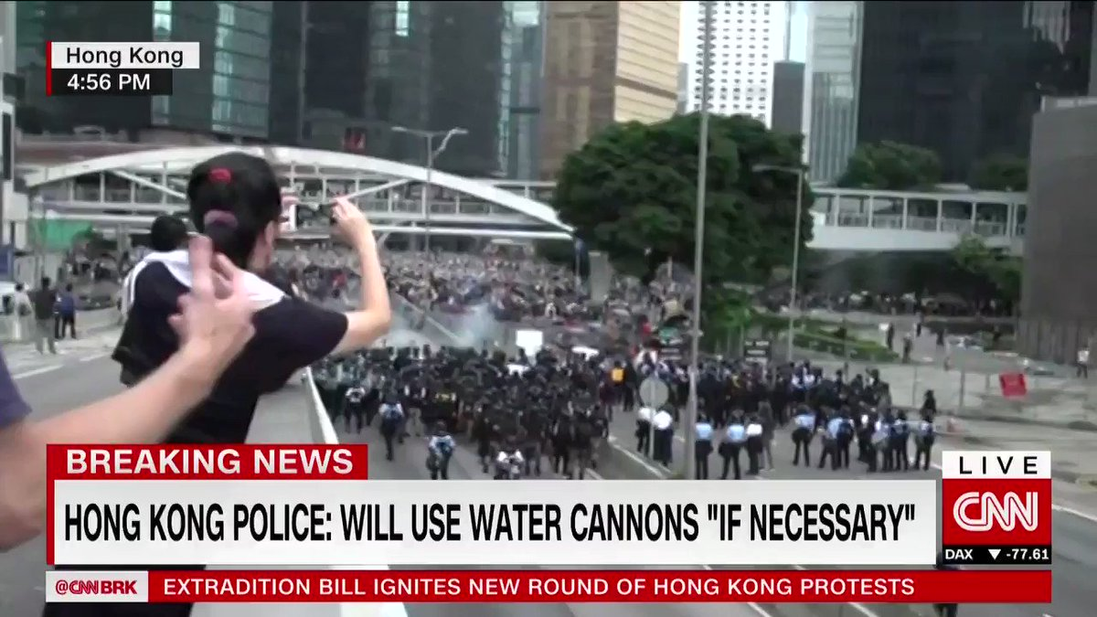 Hong Kong police fire tear gas into crowds of protesters. They have also confirmed using batons, pepper spray and rubber bullets to disperse demonstrators. Live updates: http://cnn.it/2I8XJQq
