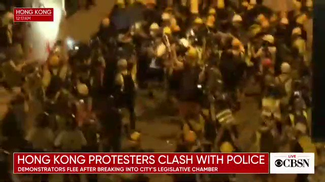 Hong Kong protests: at least 50 injured, reports say, after police