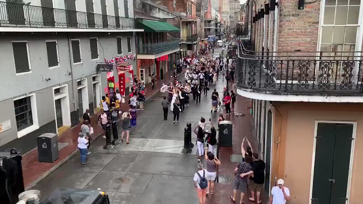 Love can weather any storm! Tropical Storm Barry didn't stop these newlyweds from second-lining through the French Quarter!