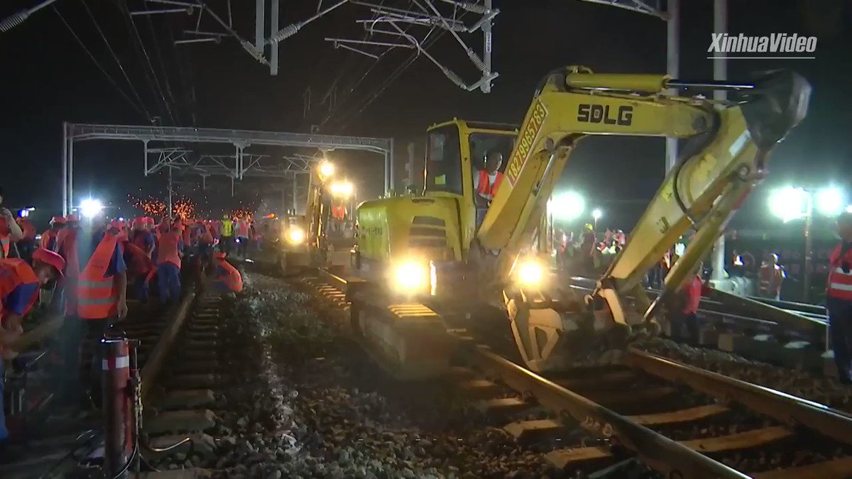 Amazing speed: 1,000+ staff work 8 hours overnight to link an under-construction railway to China's sprawling high-speed rail network.