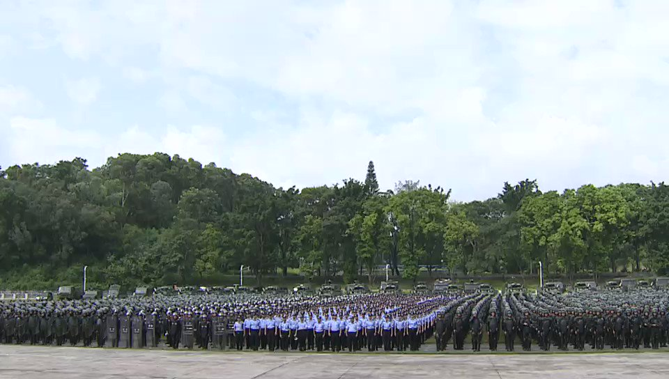 Police and armed police forces held a joint training in Shenzhen, Guangdong Province, which is adjacent to Hong Kong, on Saturday