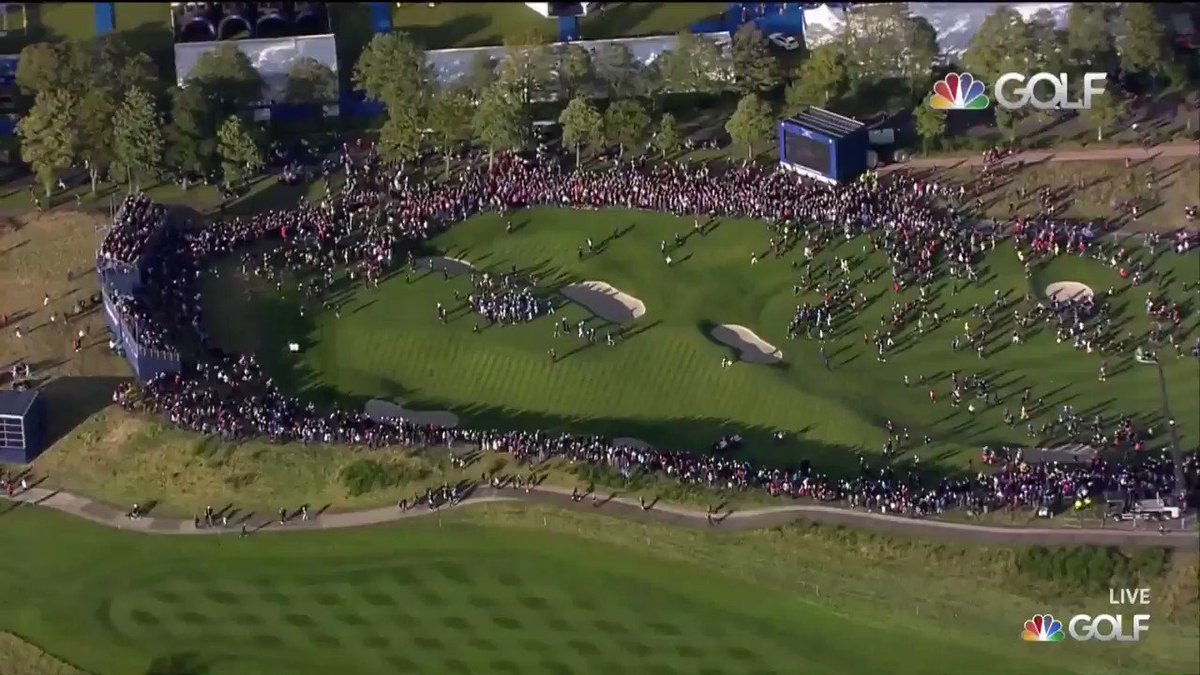 What. A. Scene.  Fans storm 18 in celebration of Team Europe's victory at #SolheimCup2019.