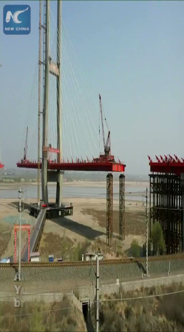 This cable-stayed bridge across the Yellow River is near completion in western China. Watch how it was constructed