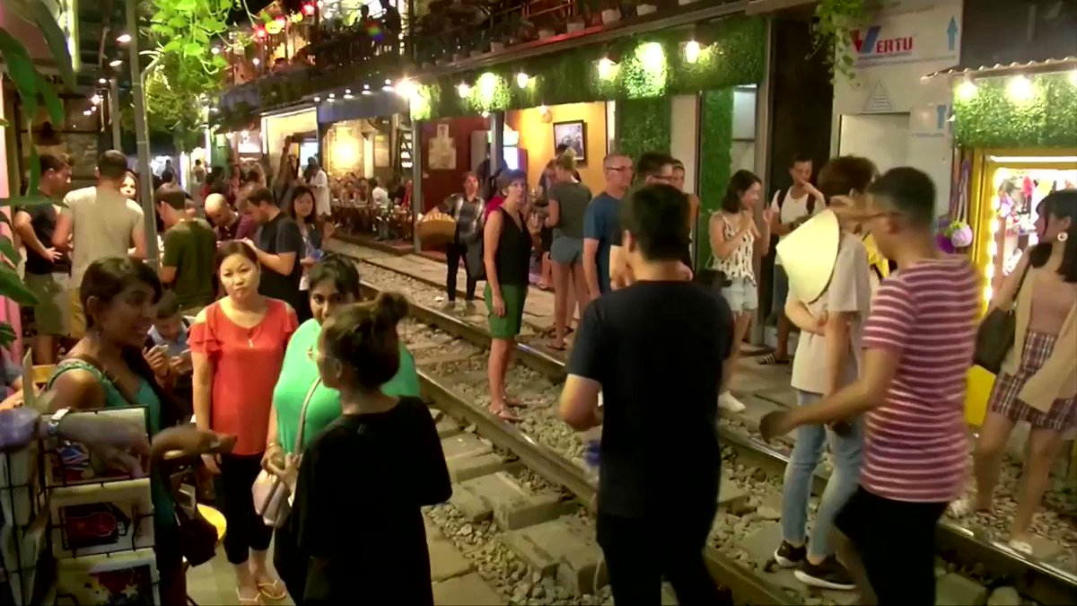 Vietnam orders the removal of dozens of popular cafes located along Hanoirailway tracks after a train came close to hitting touristshttps://reut.rs/33iKjsN