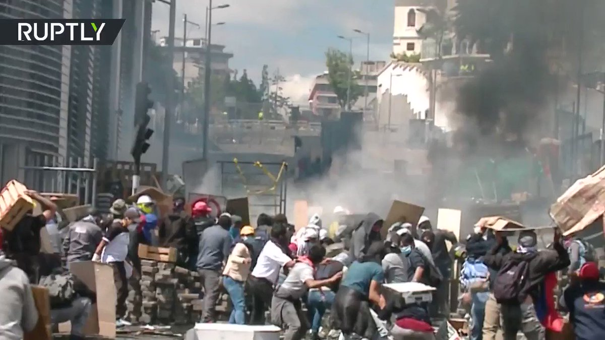 Protesters clash with police, set govt building on fire in Quito,