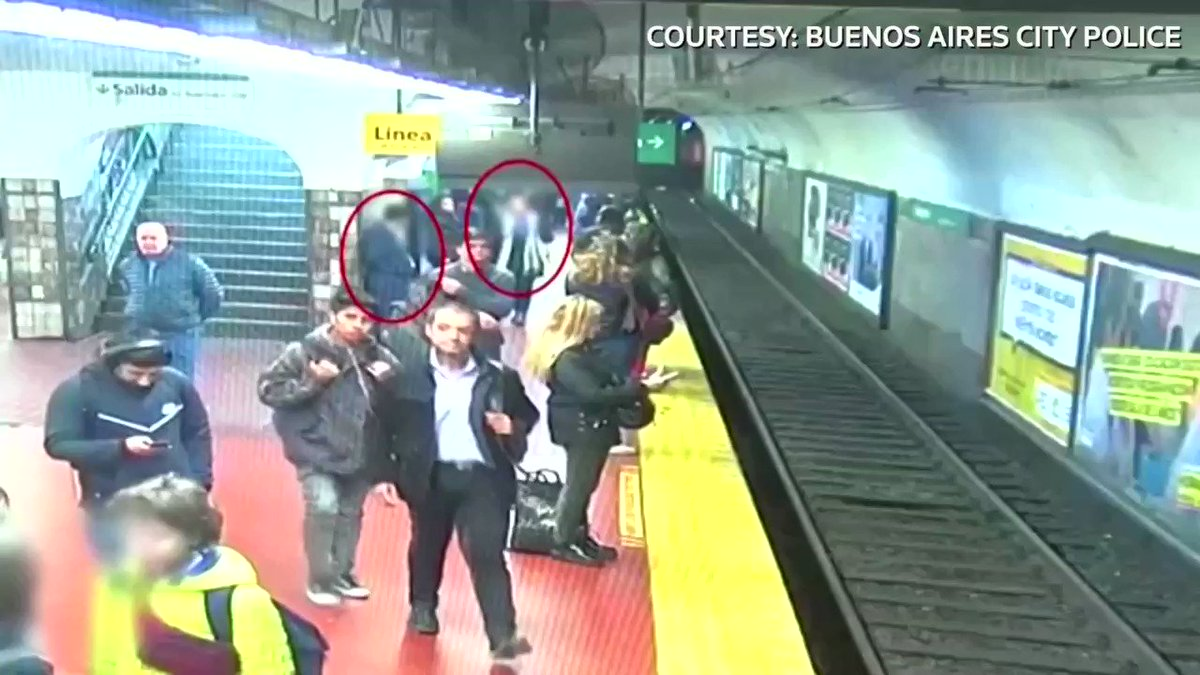 People on a crowded subway platform in Buenos Aires came to the rescue of a woman who fell onto the tracks of an oncoming subway car