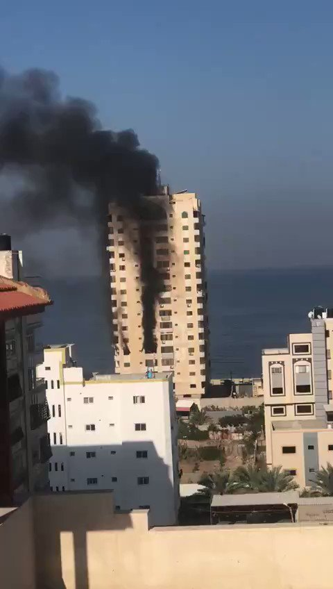 Israeli occupation warplanes target apartment in a residential building in the west of #Gaza city. #IsraeliCrimes #GazaUnderAttack