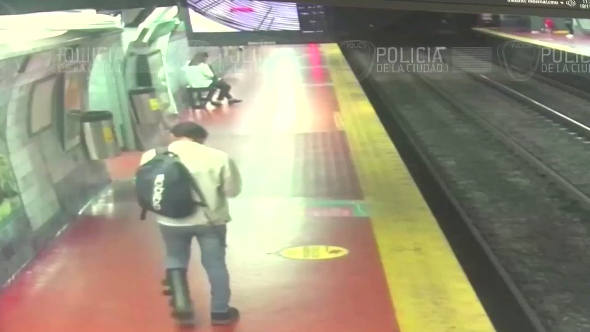 Image result for A subway commuter distracted by his cell phone has a close call on the subway tracks