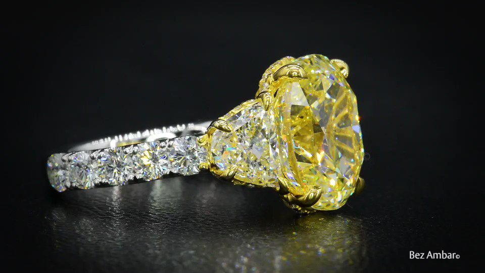 An enamoring oval shaped fancy yellow diamond by Bez Ambar. Send this to someone who would love this stunning design!  #BezAmbar #HighJewelry #Jewelry #CustomJewelry #Wedding #Diamonds #Diamonds #LosAngeles #JewelryDesigner #YellowDiamond #EngagementRing #Engaged #Wedding