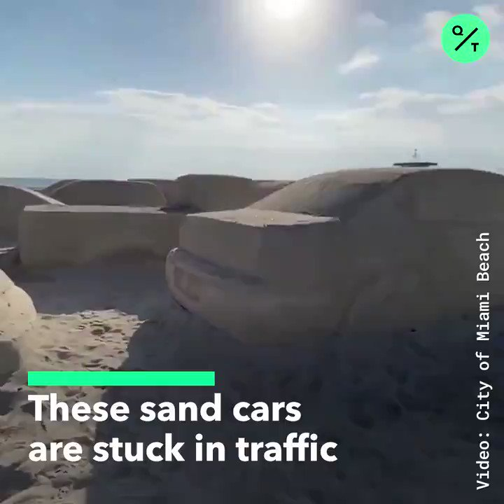A massive sand sculpture depicting a traffic jam is calling attention to climate change