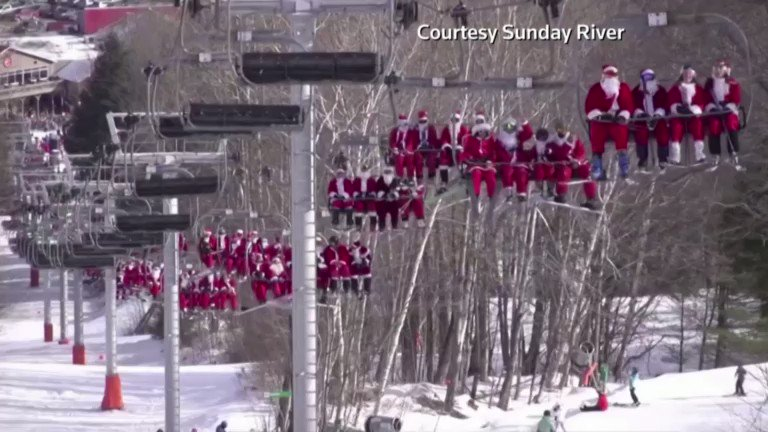 Image for the Tweet beginning: Hundreds of skiing Santas bring