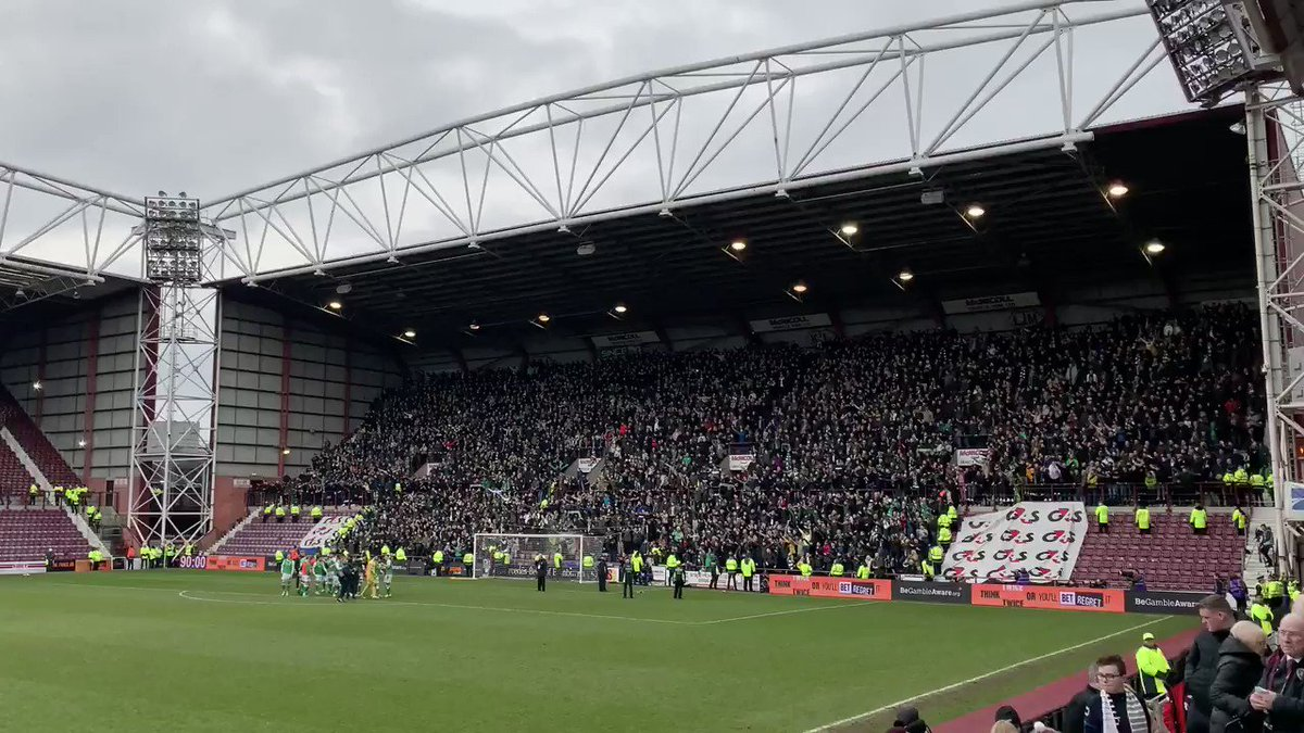 Hibs fans celebrate their derby victory at Tynecastle - 26/12/2019