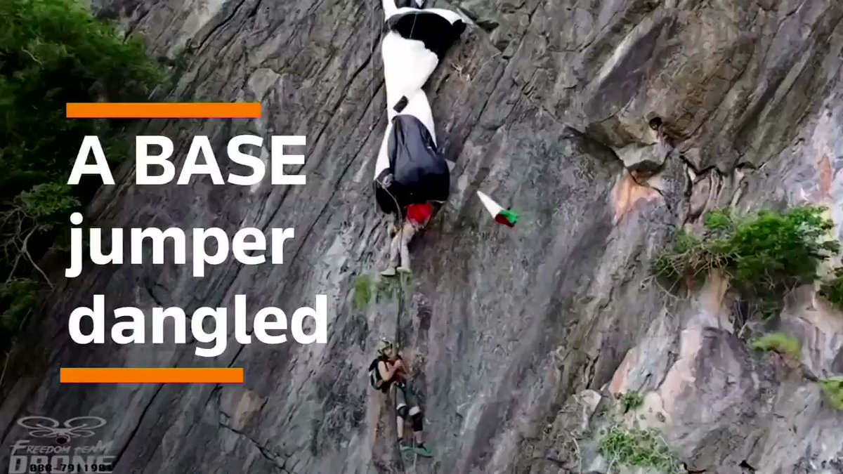 WATCH - A drone caught the moment when an Austrian BASE jumper was rescued by a Thai climber hundreds of feet above the ground  https://reut.rs/386ohMj