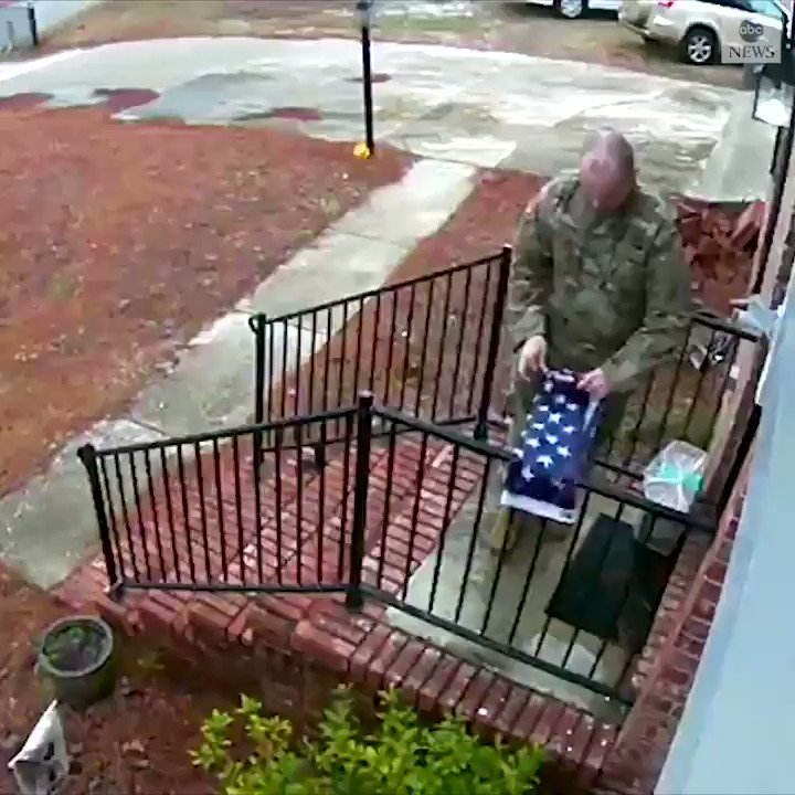 HONOR THE FLAG: A man wearing military garb was seen on a North Carolina residents security camera picking up and then properly folding an American flag that was torn from its pole during a storm, before leaving it at the door and walking off. abcn.ws/3asK4zF