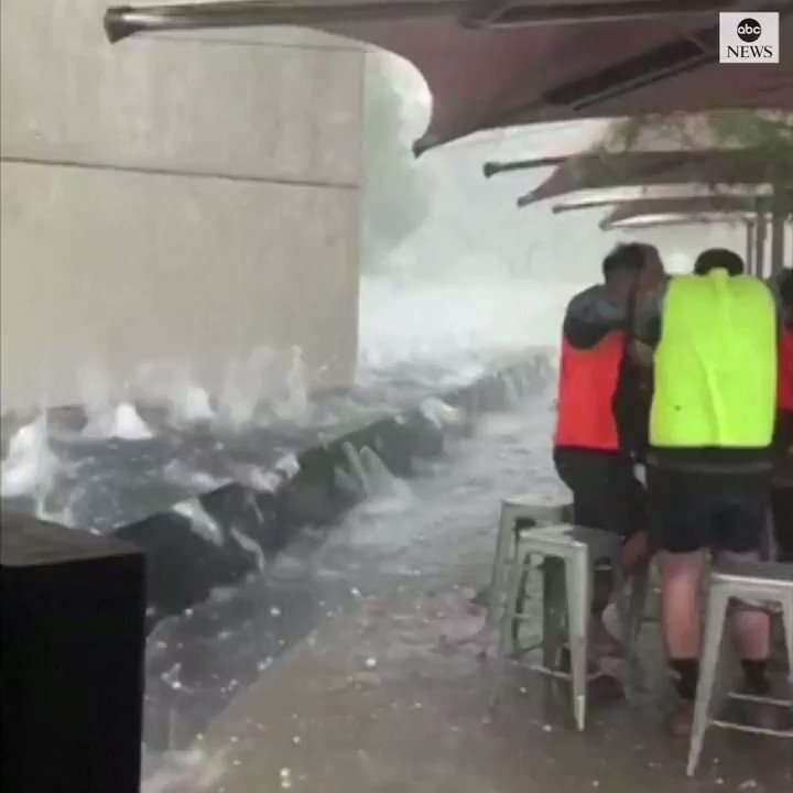 People take shelter from golf ball-sized hail stones, as an intense storm batters Canberra, Australia's capital city. https://abcn.ws/36d1xJc