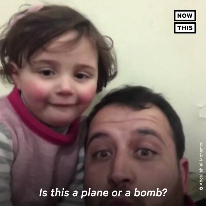 This father is using laughter to teach his young daughter how to remain calm during air raids in Syria
