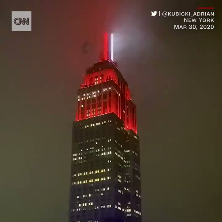 New Yorks Empire State Building was lit up like an ambulance siren on Monday night in tribute to medical workers fighting coronavirus. The Empire State Realty Trust said the lights symbolized America's heartbeat and a siren of red and white. cnn.it/2UuVc9o