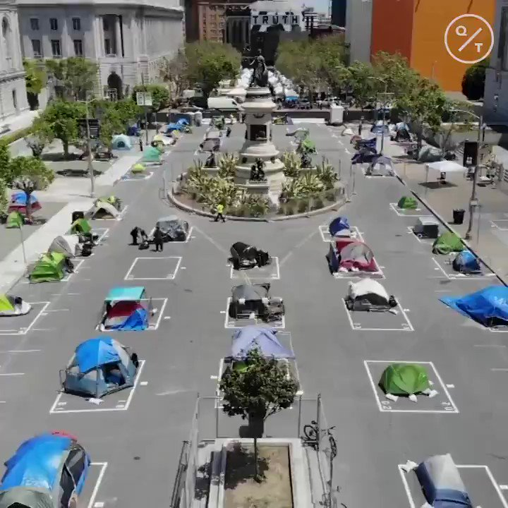 """San Francisco has authorized homeless tent encampments in response to #coronavirus.  About 80 tents are spaced out near City Hall as part of a """"safe sleeping village"""" https://t.co/6eDScNotZE"""