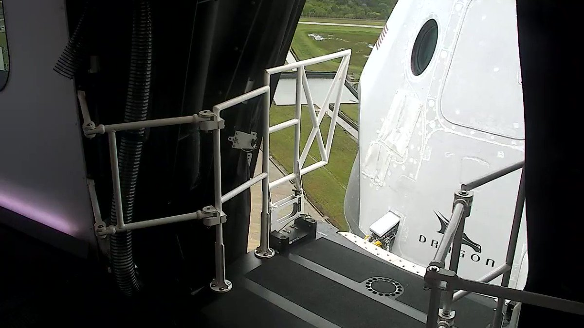 Crew access arm retracting from the spacecraft