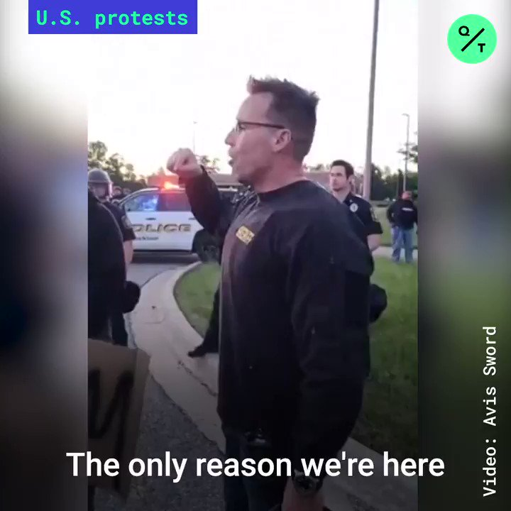 """""""Walk with us!""""  A crowd of demonstrators in Michigan cheer as the sheriff joins them to march in solidarity over the death of #GeorgeFloyd and police violence https://t.co/5Q9GvFMTj2"""