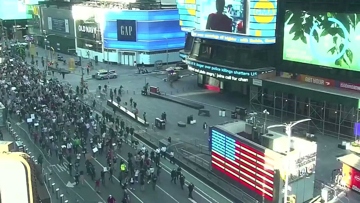 Protesters take a knee during a peaceful demonstration in Times Square in New York. Follow live updates: https://t.co/tE6sggbi2U https://t.co/3d9Ky56nnV