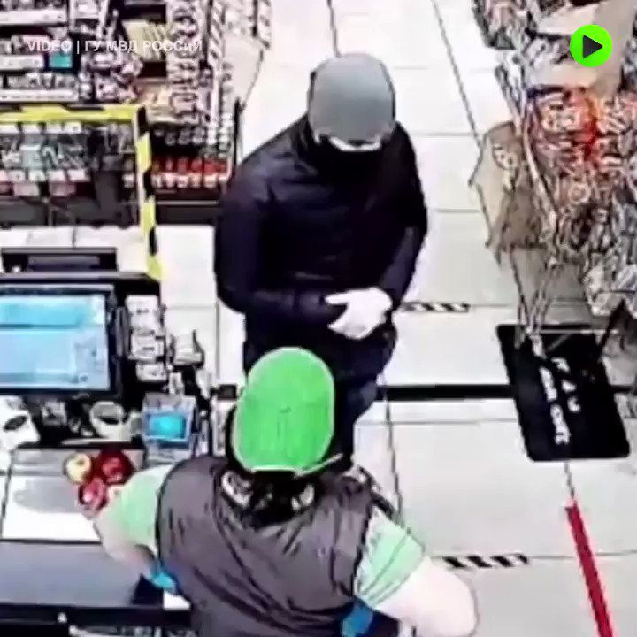 Knife-wielding robber has a change of heart and tries to hug the cashier!