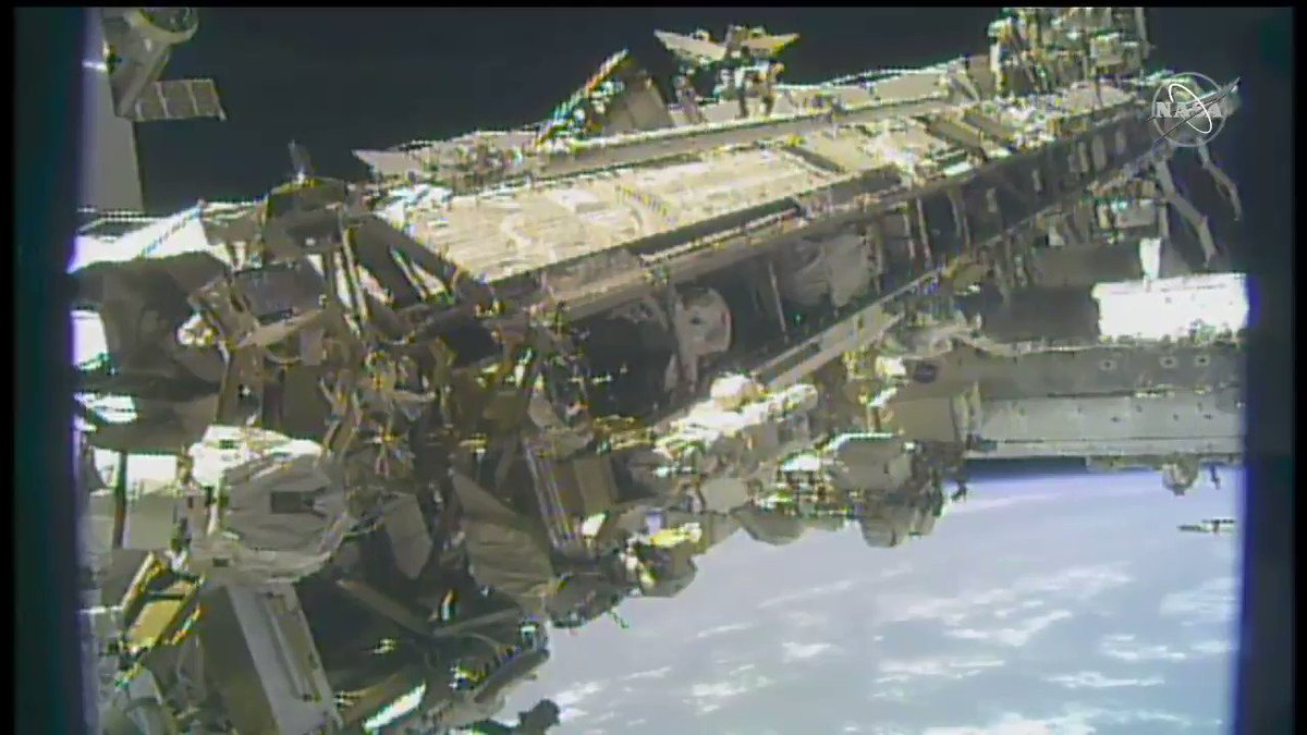 Spacewalkers @Astro_SEAL and @AstroBehnken make their way back to the station's airlock, wrapping today's upgrades outside the orbital lab.