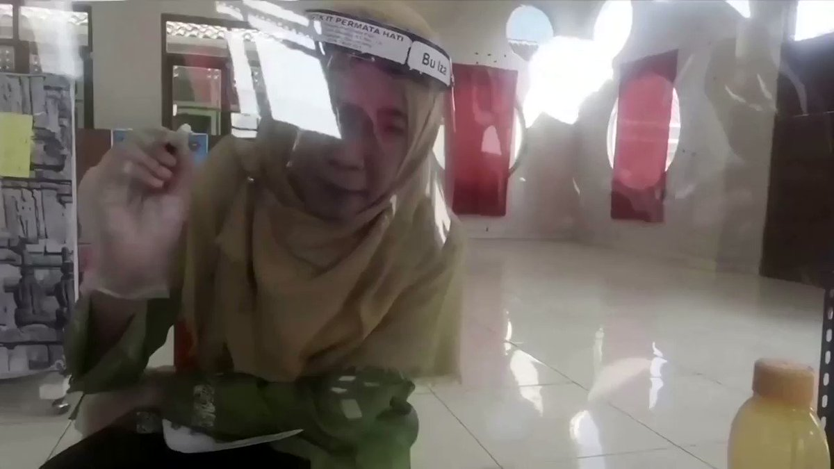 WATCH: A kindergarten in Indonesia is getting pupils back in the classroom by using makeshift transparent cubicles and sending teachers on home visits with social distancing barriers https://t.co/esYS96M4YZ https://t.co/J14rI70rDs