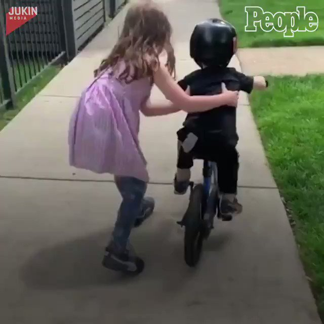 Replying to @people: This little boy's biggest cheerleader is his older sister. ❤️