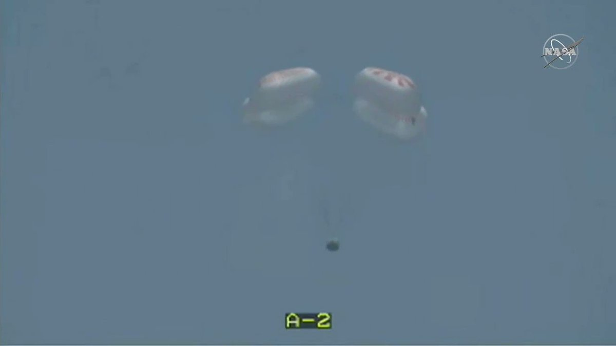 And the first splashdown for @NASA_Astronauts since 1975! @AstroBehnken and @Astro_Doug parachuted to a landing in the sunny Gulf of Mexico today at 2:48pm ET inside their @SpaceX #CrewDragon. nasa.gov/live