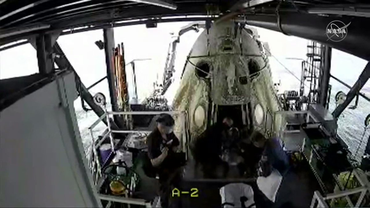 NASA astronauts @AstroBehnken & @Astro_Doug have emerged from the Crew Dragon spacecraft 👍🏼 They'll now move to a medical area on the ship for medical checks. A helicopter will then take them to Pensacola Naval Air Station, where they'll board a NASA plane to fly to Houston.