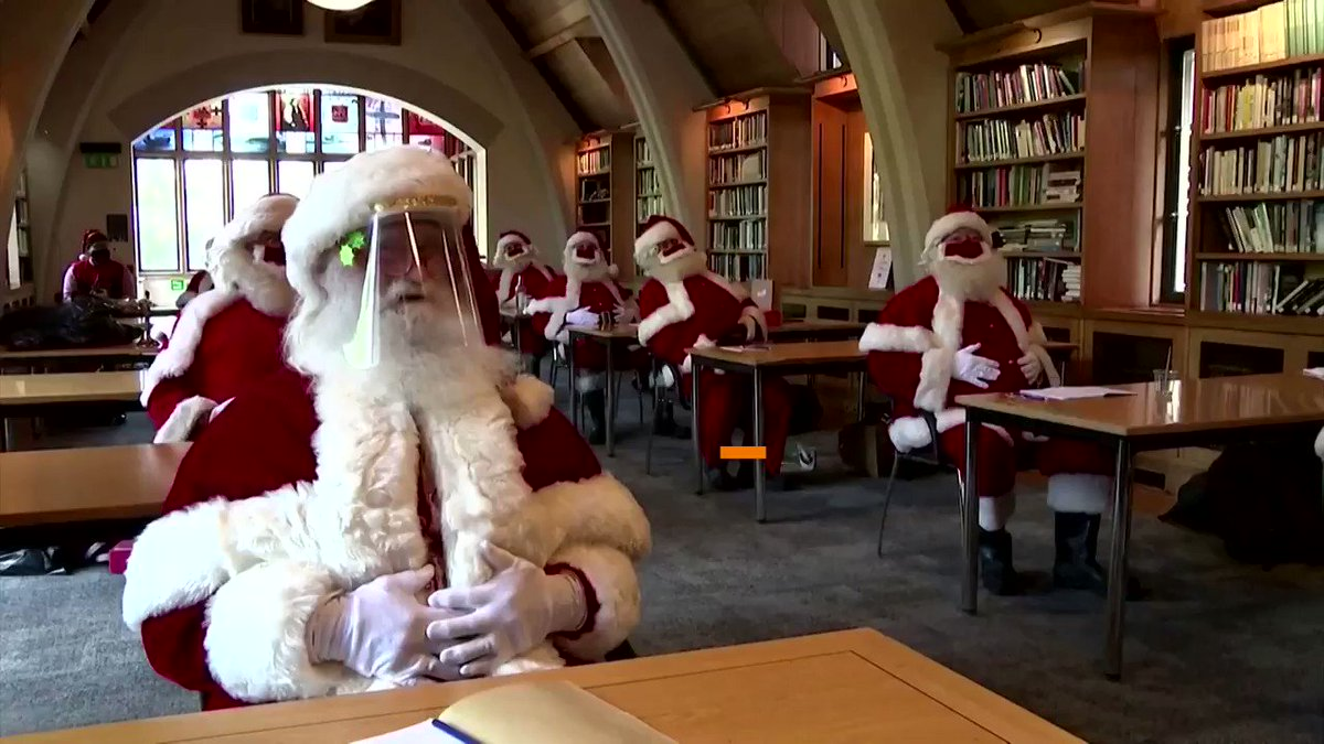 WATCH: Trainee Santas in Britain are learning how to make their grottos safe for Christmas this year, with festive red velvet masks, spaced seating and contact-free gift giving https://t.co/kIrN01xxKS https://t.co/CMggV2u2bp