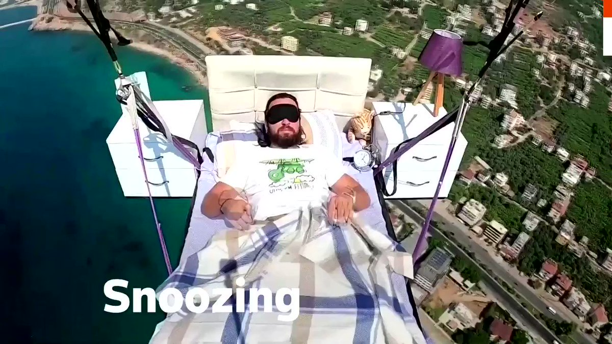 Turkish paraglider takes a nap on a literal 'airbed' complete with a table, lamp and alarm clock https://t.co/iPEV5DkVWb