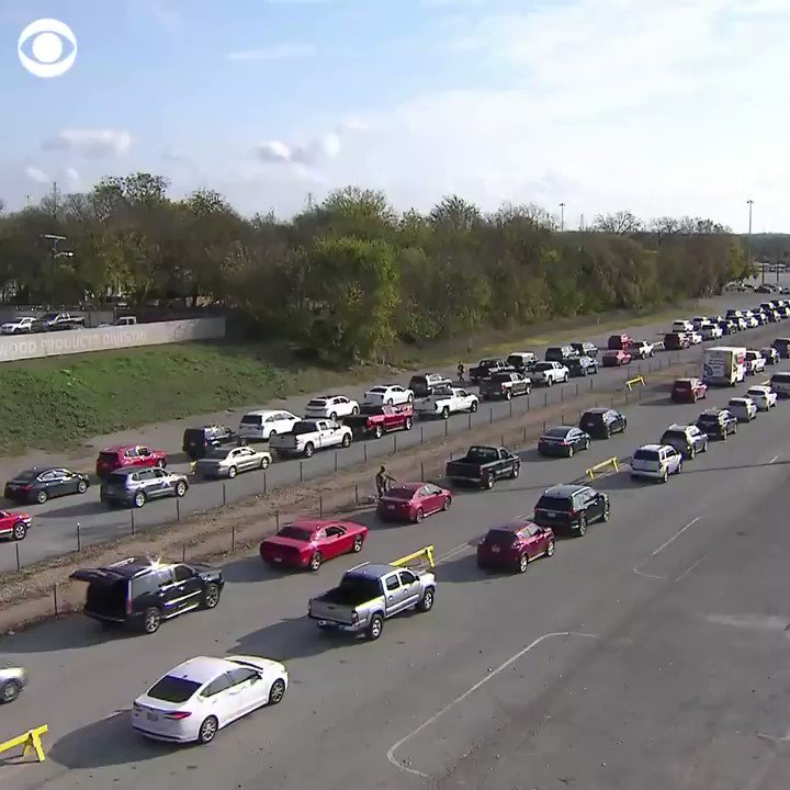 Thousands of cars lined up to collect food in Dallas, Texas, over the weekend, stretching as far as the eye can see.