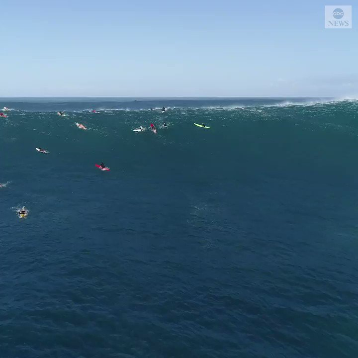 Stunning drone footage saw surfers in Hawaii catching the biggest swells of the season with surf reaching 50 feet on Saturday.