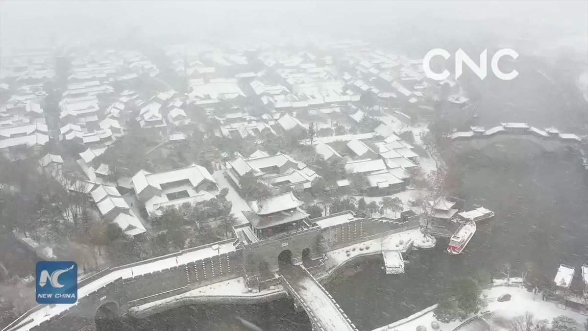 The ancient city of Taierzhuang in Shandong Province, which sits on the banks of the Beijing-Hangzhou Grand Canal, is blanketed with snow. Seen from a distance, the ancient buildings are looming in the falling snow, just like ink paintings.    #ChinaFromAbove