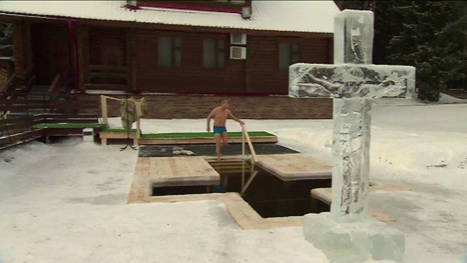 Russian President Vladimir Putin takes an icy dip to mark Epiphany Photo