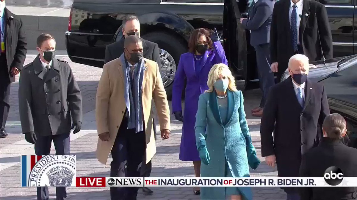 Eugene Goodman, a Capitol police officer who fought off a mob of rioters two weeks ago, escorts VP-elect Kamala Harris to the inauguration ceremony.    #InaugurationDay