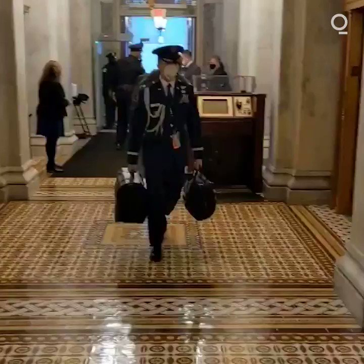 "WATCH: One of two ""nuclear footballs"" was transported through the U.S. Capitol this morning ahead of Joe Biden's inauguration"