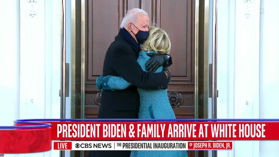 President Biden hugs first lady Jill Biden before they enter the White House for the first time since he was sworn in