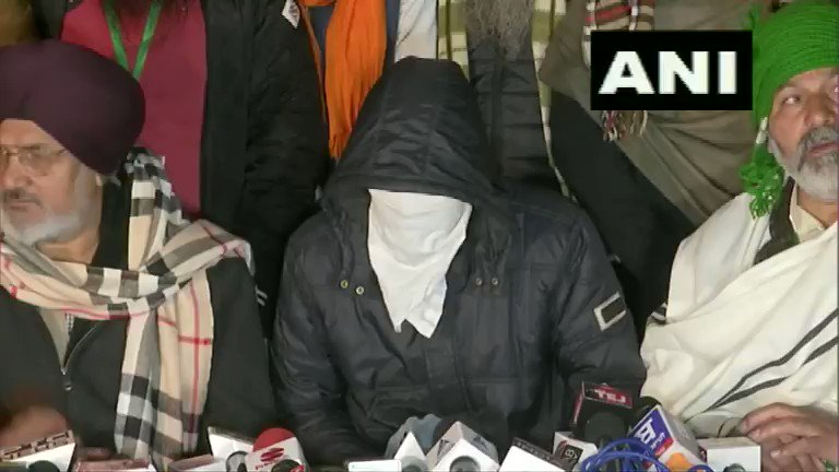 #WATCH | Delhi: Farmers at Singhu border present a person who alleges a plot to shoot four farmer leaders and cause disruption; says there were plans to cause disruption during farmers' tractor march on Jan 26.