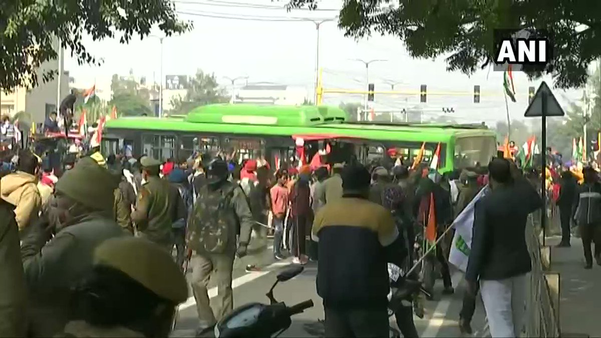 #WATCH Delhi: Protesting farmers vandalise a DTC bus in ITO area of the national capital.