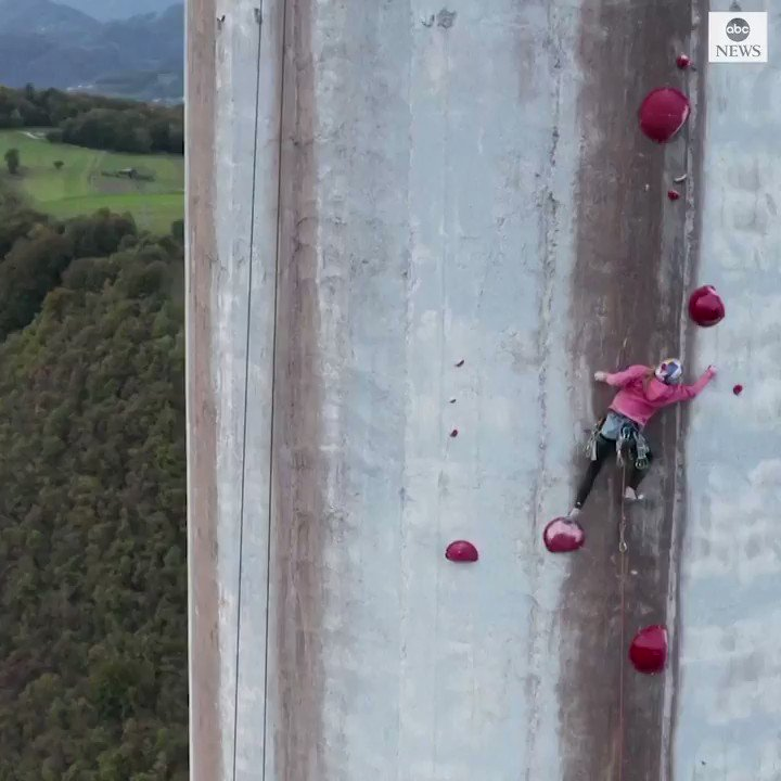 DON'T LOOK DOWN: Two climbers completed a hair-raising challenge - scaling Europe's highest chimney, which stands over 1,100 ft tall.